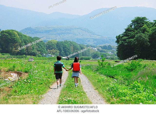 Friends Walking Trough Rural Path