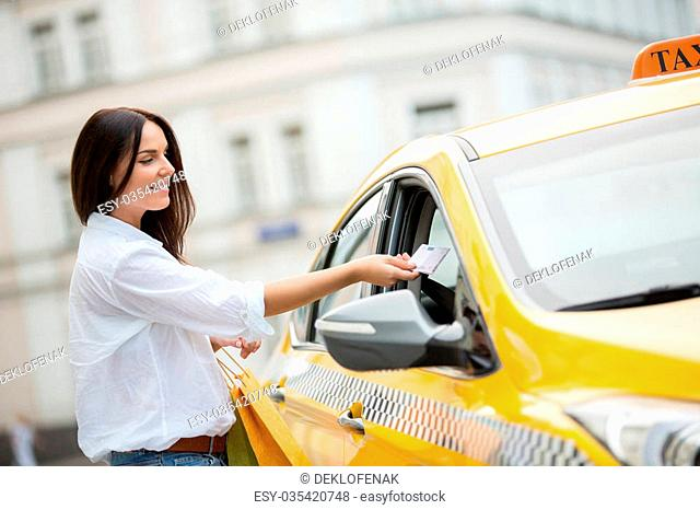 Young girl pays for taxis