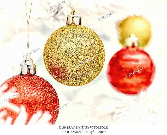 Red and golden balls decorates the white christmas tree - vintage tinted