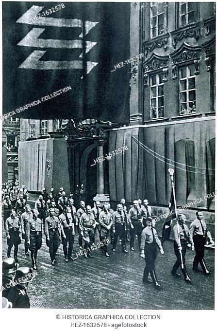 Hitler and Goering leading a rally through Munich on Martyrs' Day, 9th November, 1935. From Deutsche Gedenkhalle: Das Neue Deutschland compiled by General Von...