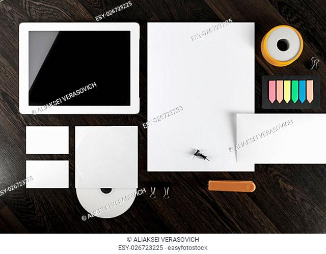 Corporate identity template on dark wooden background. Top view