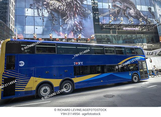 The all-new double-decker test bus passes through Midtown Manhattan in New York on Thursday, May 3, 2018. The higher capacity bus running as a test will travel...