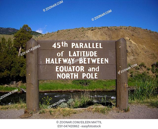 45th parallel of Latitude sign in Yellowstone Park, halfway between Equator and North Pole