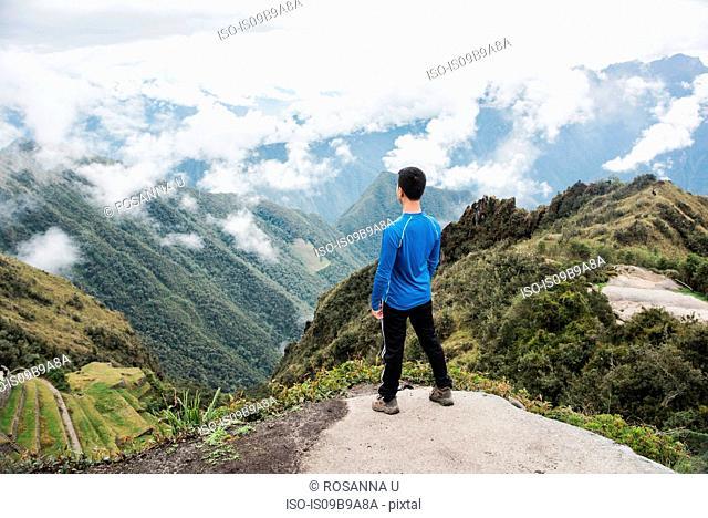 Man looking at view, enroute to Machu Picchu via the Inca Trail, Huanuco, Peru, South America