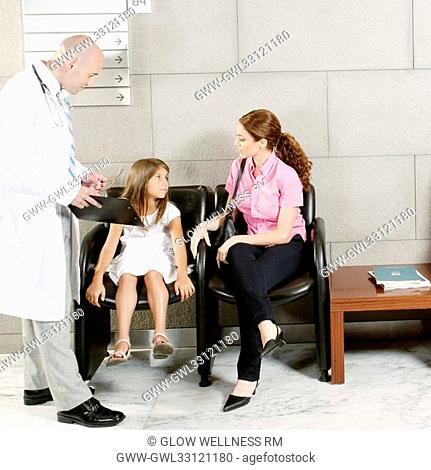 Patients and a doctor in a waiting room
