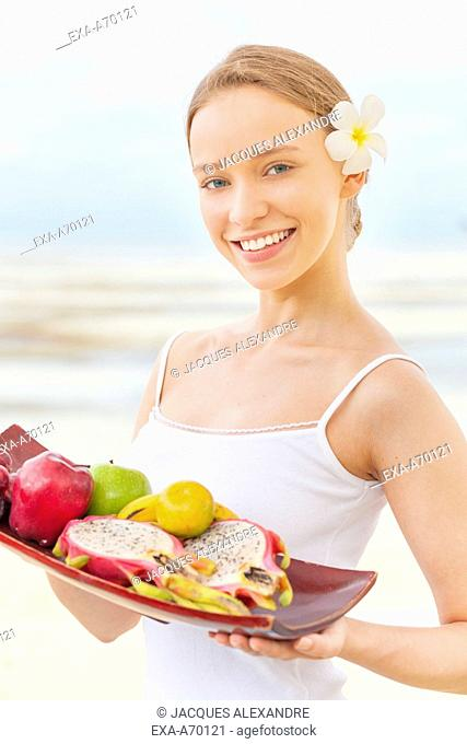 woman with fruits plate