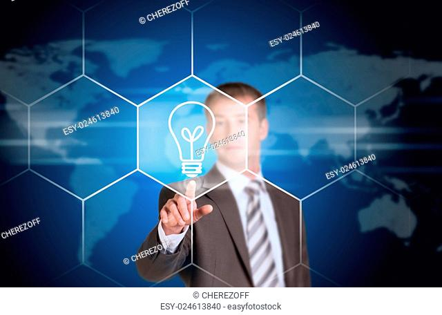 Business man pointing her finger at light bulb icon. Technology concept. World map as backdrop