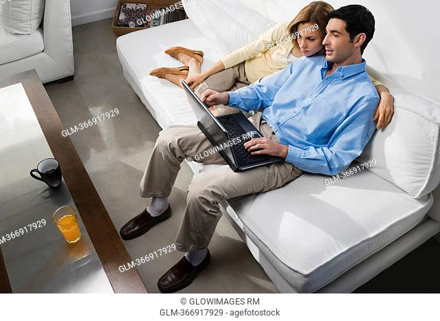 High angle view of a mid adult couple using a laptop