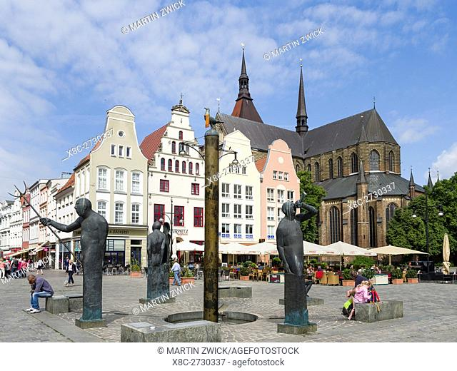 Fountain Moewenbrunnen by Waldemar Otto at the Neuer Markt (new market). The hanseatic city of Rostock at the coast of the german baltic sea