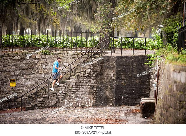 Jogger along the river walk, Savannah, Georgia, USA