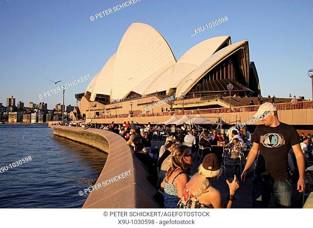 Opera Bar customers in front of the famous opera in Sydney, New South Wales, Australia