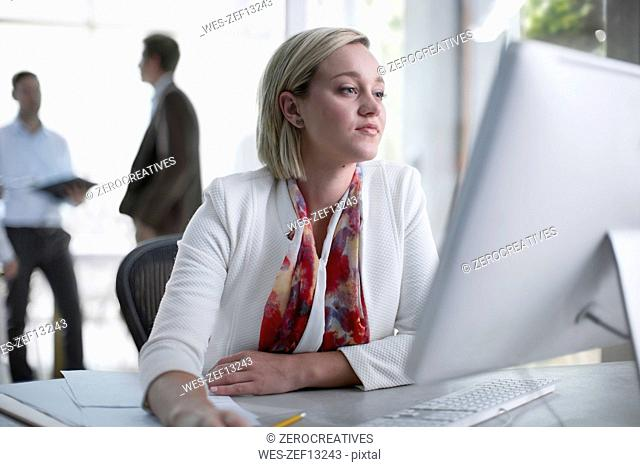Mid adult businesswoman working in office