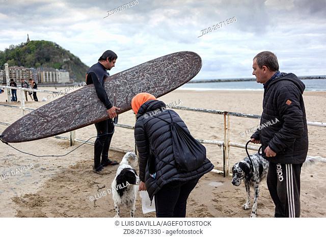 surfers in zurriola beach. san sebastian. spain