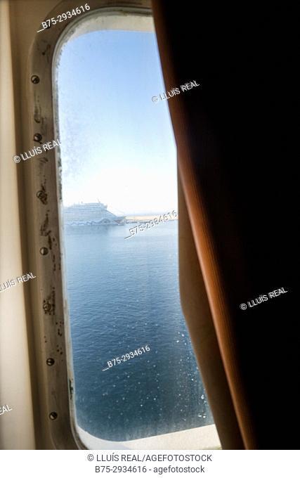 Sunrise seen from behind a ferry boat window. Mediterranean Coast, Palma, Majorca, Balearic Islands, Spain