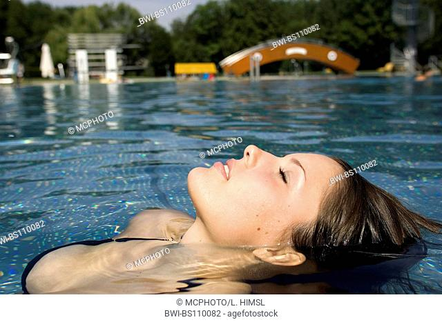 young woman lying in water, Austria