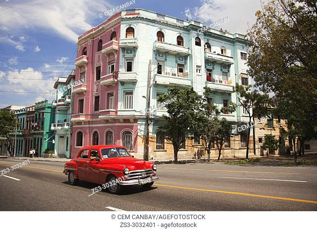 Old American car used as taxi in front of the colonial buildings at Vedado district, Havana, La Habana, Cuba, Central America