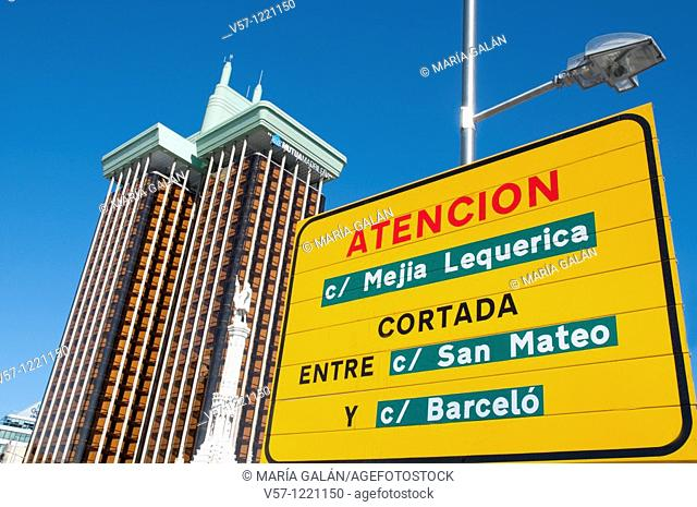 Signpost, Jerez Towers and Colón statue, Colón Square. Madrid, Spain