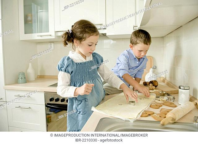 Brother and sister baking cookies