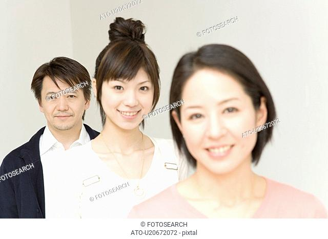 Portrait of Family, Parents and Daughter, Standing in Line, Front View, Looking at Camera, Differential Focus