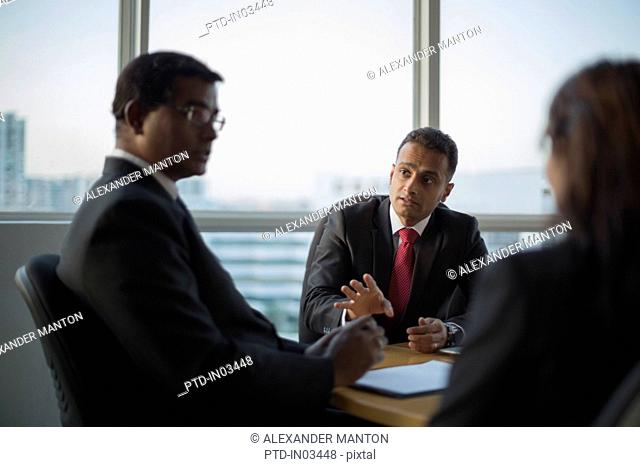 Singapore, Three business colleagues in discussion