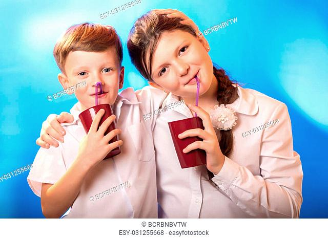 boy and the girl drunk from a cup a straw