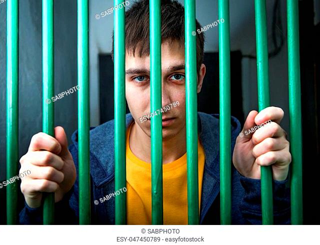 Jailed Young Man behind bars in a Cell