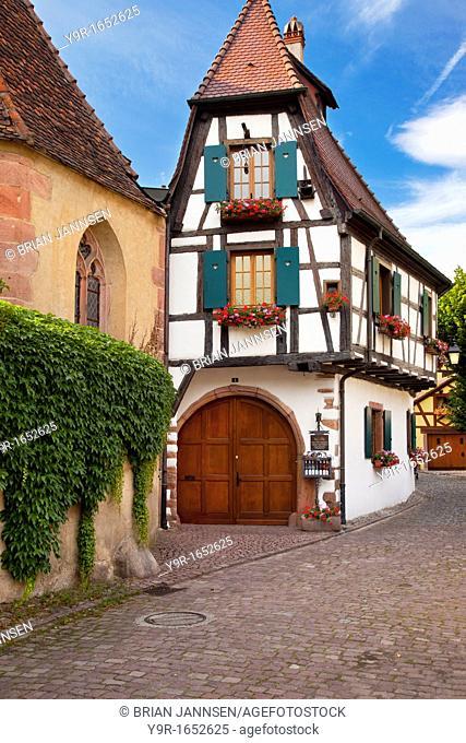 Village street scene in Kaysersberg along the wine route, Alsace Haut-Rhin France