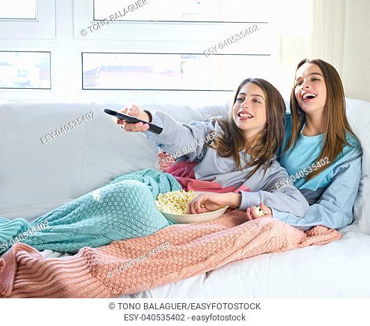 best friend girls watching TV cinema at home with popcorn