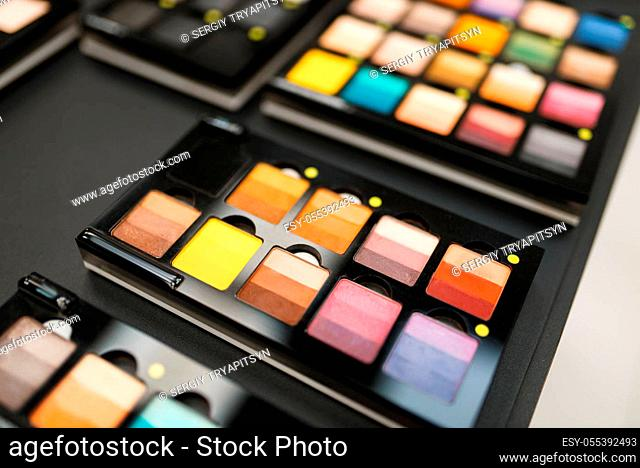 Showcase with powder and shadows in cosmetics store, nobody. Luxury beauty shop, shelf with products in fashion store