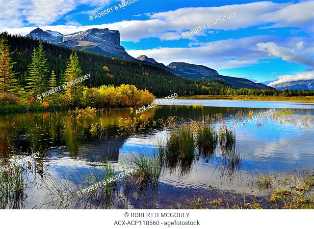 An autumn landscape image of Roche Miette mountain standing tall at the entrance to Jasper National Park, in Alberta Canada