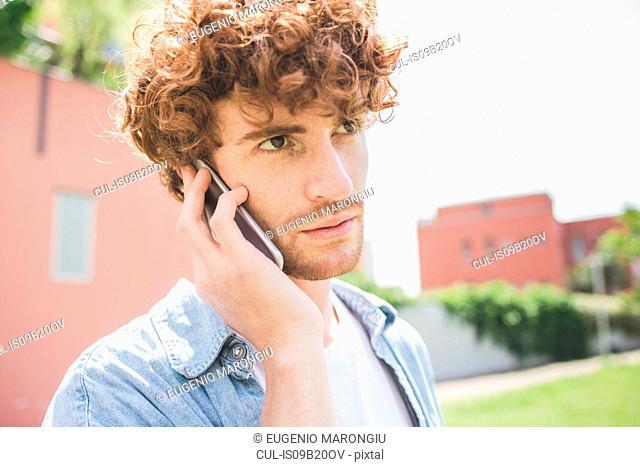 Man using cellular phone outdoors