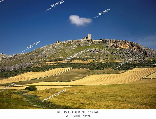 Ruins of Estrella Castle on hilltop above Teba Malaga Spain with farm fields