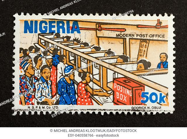 NIGERIA - CIRCA 1980: Stamp printed in Nigeria shows a modern post office 1980