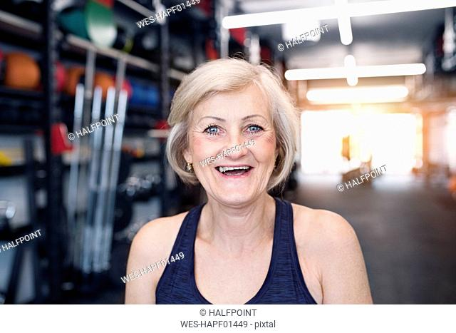 Portrait of happy senior woman in gym