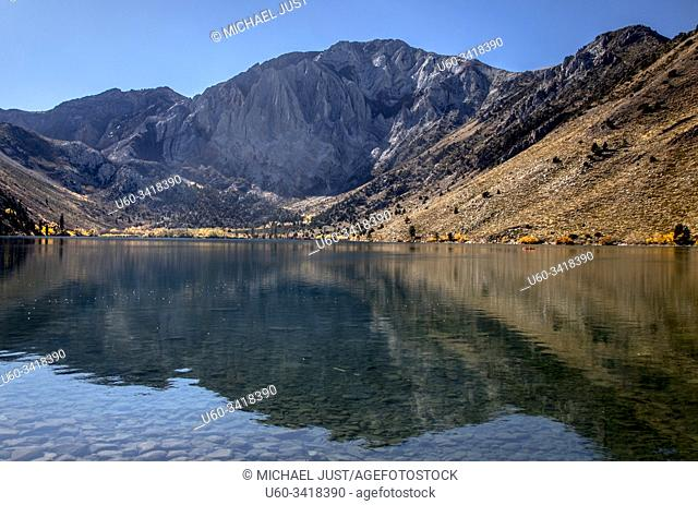 The Sierra Nevada Mountins are reflected in the waters of Convict Lake at Owens Valley, California