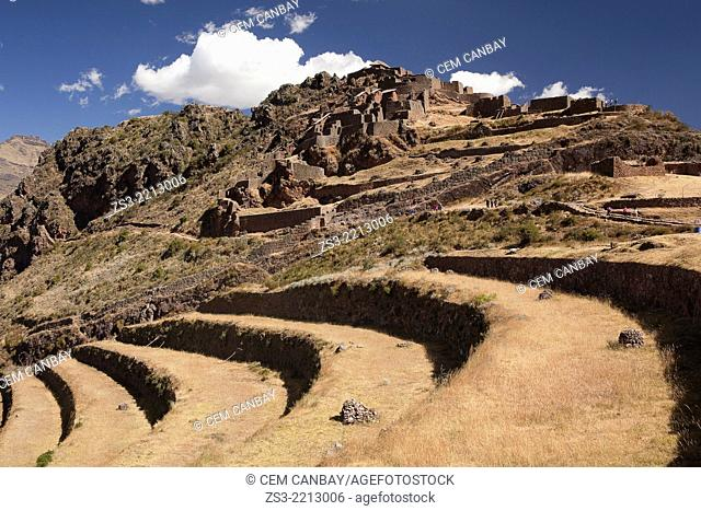 Visitors walking at the Pisac Ruins of the Inca empire, Cusco Region, Peru, South America