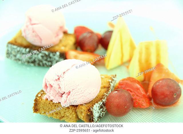 Dessert plate with strawberry ice cream fruit and sponge cake