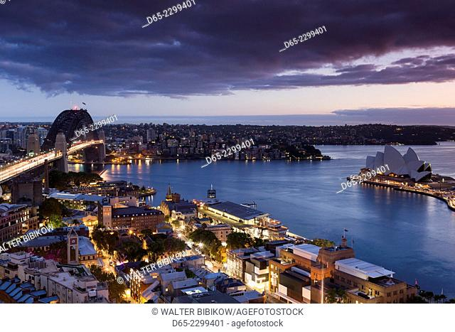 Australia, New South Wales, NSW, Sydney, The Rocks area, Sydney Harbour Bridge and Sydney Opera House, elevated view, dusk