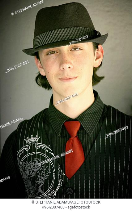 Teenager in fedora hat and red tie