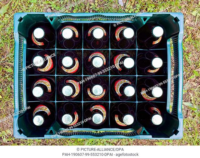 29 May 2019, Germany (German), Zella-Mehlis: A case of Rhöner Land Premium Pils beer stands on a meadow. Photo: Soeren Stache/dpa-Zentralbild/ZB