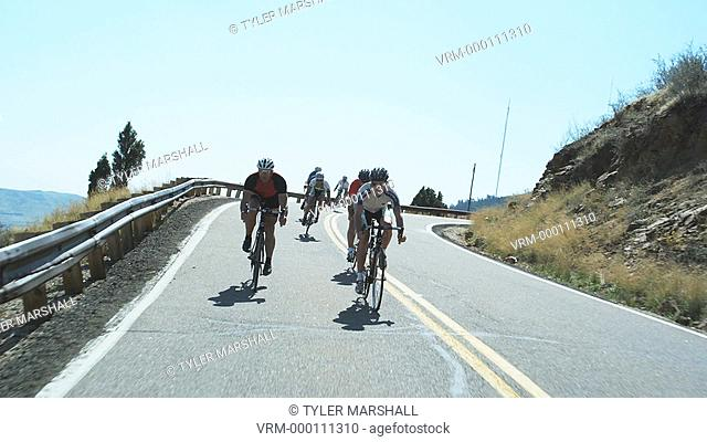cyclists coming downhill