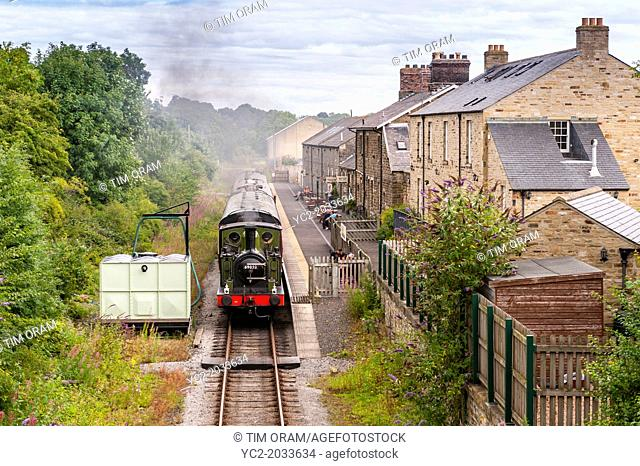 A steam train engine arrives at the Leyburn Station on the Wensleydale Railway in Leyburn , North Yorkshire, England, Britain, Uk