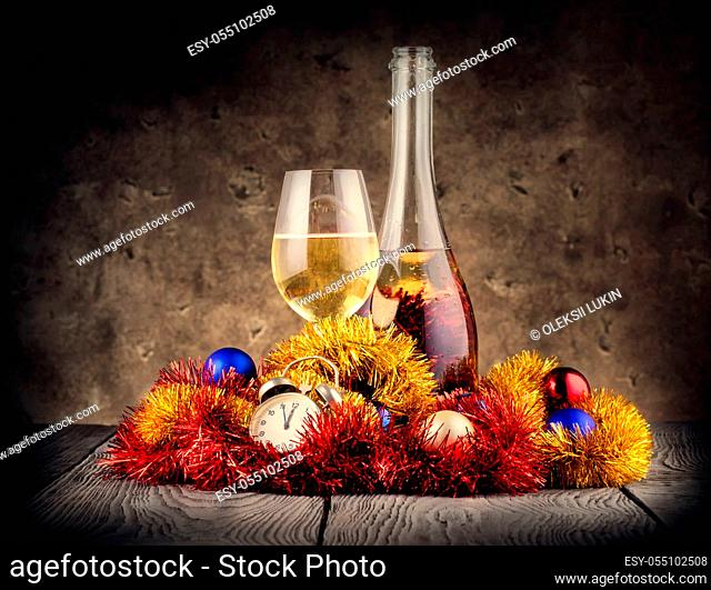 Christmas still life with champagne and clock on background decorations