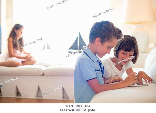 Children using tablet computer together