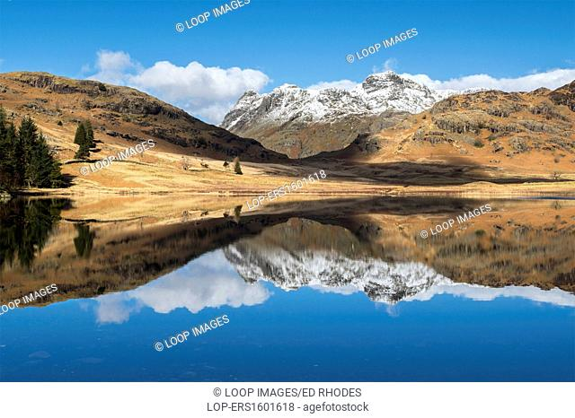 Blea Tarn and snow covered Langdale Pikes