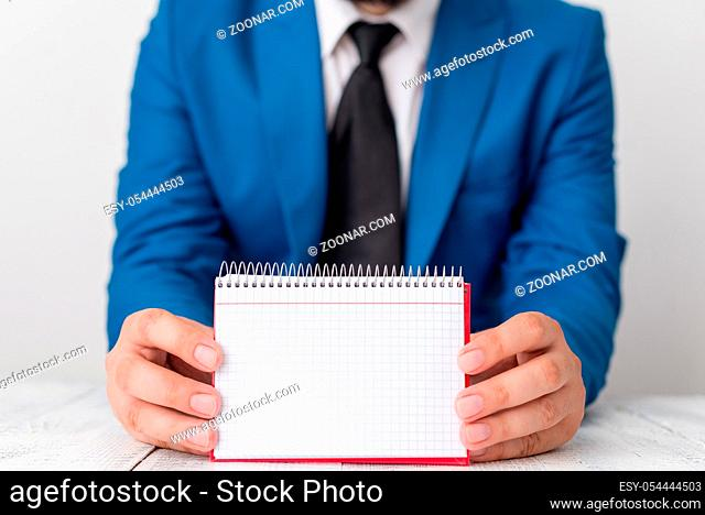 Man holds empty paper with copy space in front of him. White space for advertising message