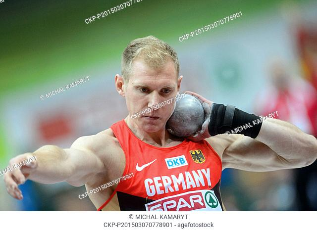 Germany's Arthur Abele makes an attempt in the shot put of the men's heptathlon during the European Athletics Indoors Championships in Prague, Czech Republic