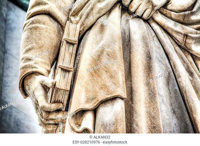 close up of Dante Alighieri statue in Florence, Italy