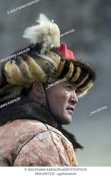 Portrait of a Kazakh eagle hunter at the Golden Eagle Festival near the city of Ulgii (Ölgii) in the Bayan-Ulgii Province in western Mongolia