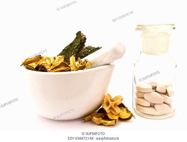 White mortar and pestle. Herbals, pills and pharmacy bottle